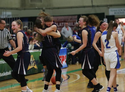 Watkins Glen players celebrate after defeating Millbrook 53-42 in the girls Class C state semifinal at Hudson Valley Community College in Troy March 15, 2019.