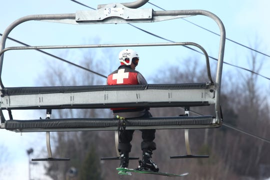 A ski patrol member rides the lift at Hunter Mountain on March 15, 2019.