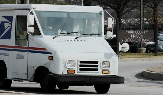 A postal vehicle passes the York County Prison Friday, March 15, 2019. The ACLU of Pennsylvania has alleged that York County Prison is violating inmates' rights with its mail policy. Bill Kalina photo
