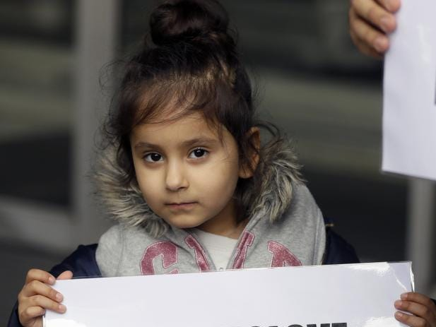 "A young demonstrator holds a banner from multi-faith group 'Turn to Love' during a vigil at New Zealand House in London, Friday, March 15, 2019. Multiple people were killed in mass shootings at two mosques full of worshippers attending Friday prayers on what the prime minister called ""one of New Zealand's darkest days,"" as authorities detained four people and defused explosive devices in what appeared to be a carefully planned attack. (AP Photo/Kirsty Wigglesworth)"