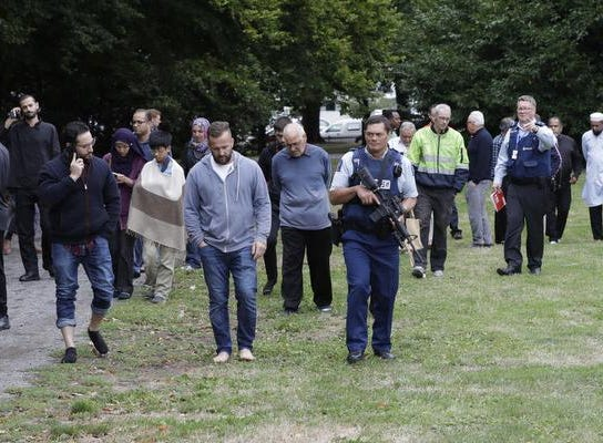 Police escort witnesses away from a mosque in central Christchurch, New Zealand, Friday, March 15, 2019.  Multiple people were killed in mass shootings at two mosques full of people attending Friday prayers, as New Zealand police warned people to stay indoors as they tried to determine if more than one gunman was involved. (AP Photo/Mark Baker)