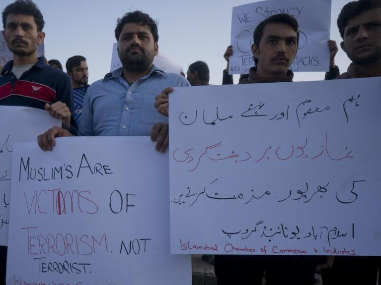 "Pakistani traders protest to condemn the New Zealand mosque shooting, in Islamabad, Pakistan, Friday, March 15, 2019. Pakistan's prime minister Imran Khan has condemned attacks on two mosques in New Zealand, saying he blames rising ""Islamophobia."" Khan wrote Friday on Twitter that ""terrorism does not have a religion."" Placard at right reads ""We strongly condemn attack on innocent and unarmed Muslim worshippers."" (AP Photo/B.K. Bangash)"