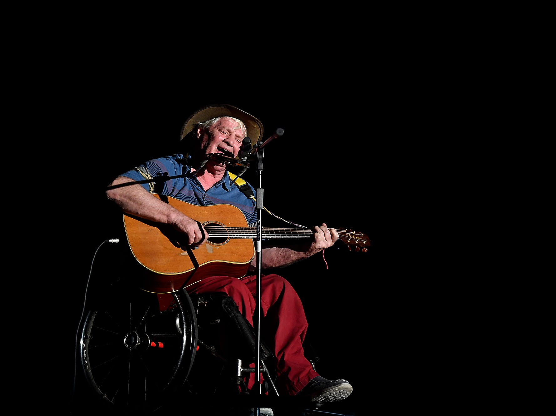 Disability rights singer and song writer Johnny Crescendo  performs during the Spring Grove Area High School third annual Diversity Festival, Thursday, March 13, 2019