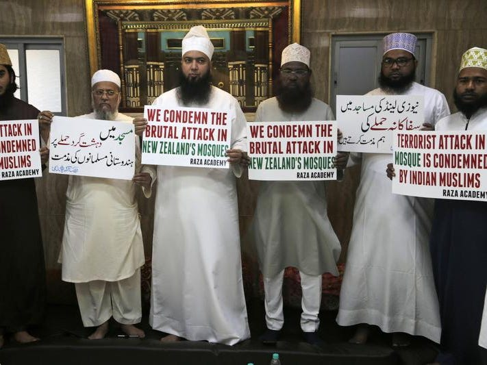 "Indian Muslims hold placards during a condolence meeting and protest against Fridays mass shootings in New Zealand in Mumbai, India, Friday, March. 15, 2019. Dozens of people were killed in mass shootings at two mosques full of worshippers attending Friday prayers on what the prime minister called ""one of New Zealand's darkest days."" (AP Photo/Rajanish Kakade)"