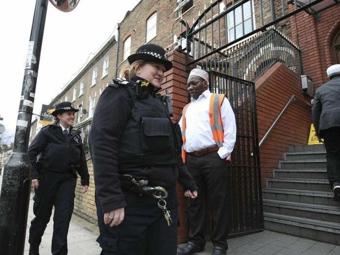 Police officers patrol the area outside Finsbury Park Mosque following the Christchurch mosque attacks in New Zealand, as worshipers begin to arrive for the Friday prayer service, in London, Friday March 15, 2019.  World leaders expressed condolences and condemnation Friday following the deadly attacks on mosques in the New Zealand city of Christchurch, while Muslim leaders said the mass shooting was evidence of a rising tide of violent anti-Islam sentiment. (Yui Mok/PA  via AP)