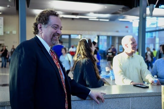Spring Grove School District's soon to be superintendent George Ioannidis greets students while taking part in the high school's third annual Diversity Festival, Thursday, March 13, 2019
