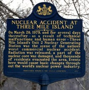 A historical marker near the Three Mile Island Nuclear Generating Station in Londonderry Township pays tribute to the 1979 incident Friday, March 15, 2019. The plant's Unit 2 reactors have been shut down since the March 28,1979, partial meltdown. Bill Kalina photo