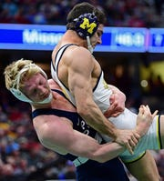 Penn State's Bo Nickal takes down Michigan's Domenic Abounader during a 184-pound bout at the 2018 NCAA Wrestling Championships.