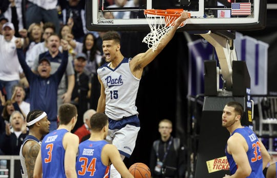 Nevada's Trey Porter (15) throws down a second-half dunk against Boise State on Thursday.