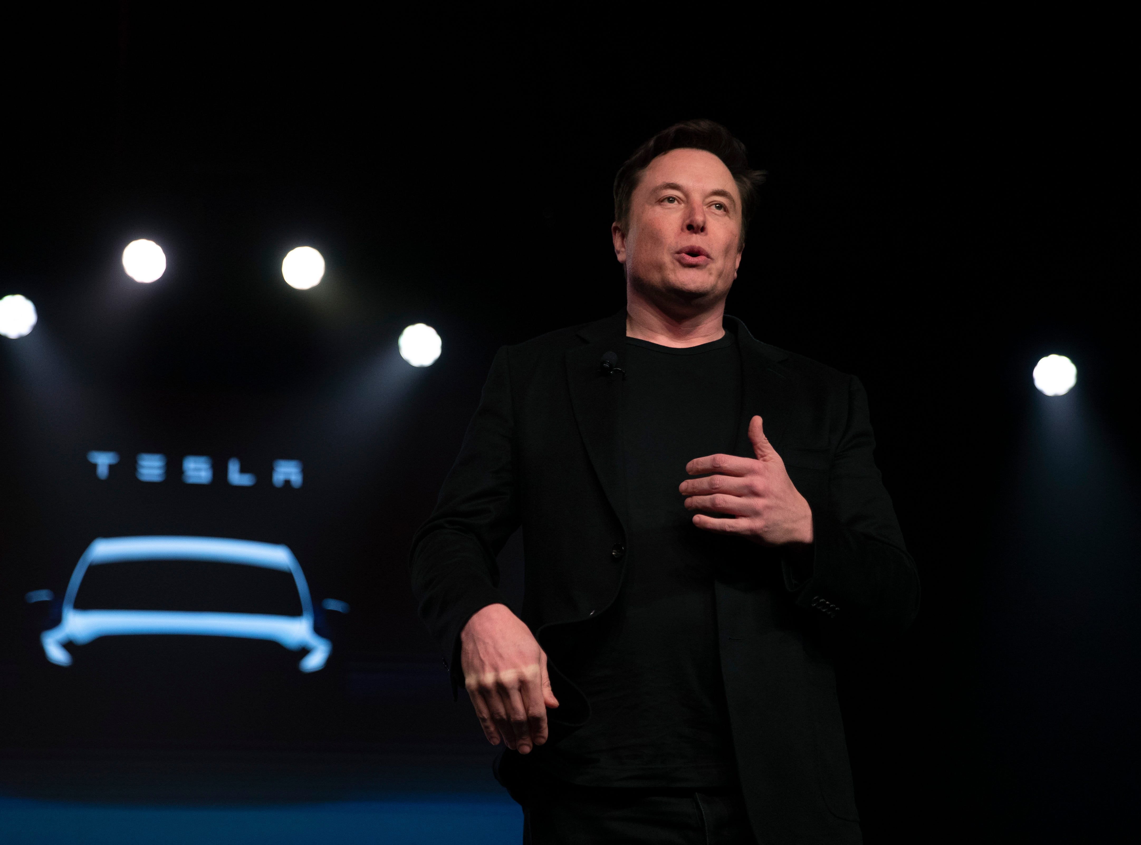 Tesla CEO Elon Musk speaks before unveiling the Model Y at the company's design studio Thursday, March 14, 2019, in Hawthorne, Calif. The Model Y may be Tesla's most important product yet as it attempts to expand into the mainstream and generate enough cash to repay massive debts that threaten to topple the Palo Alto, California, company. (AP Photo/Jae C. Hong)