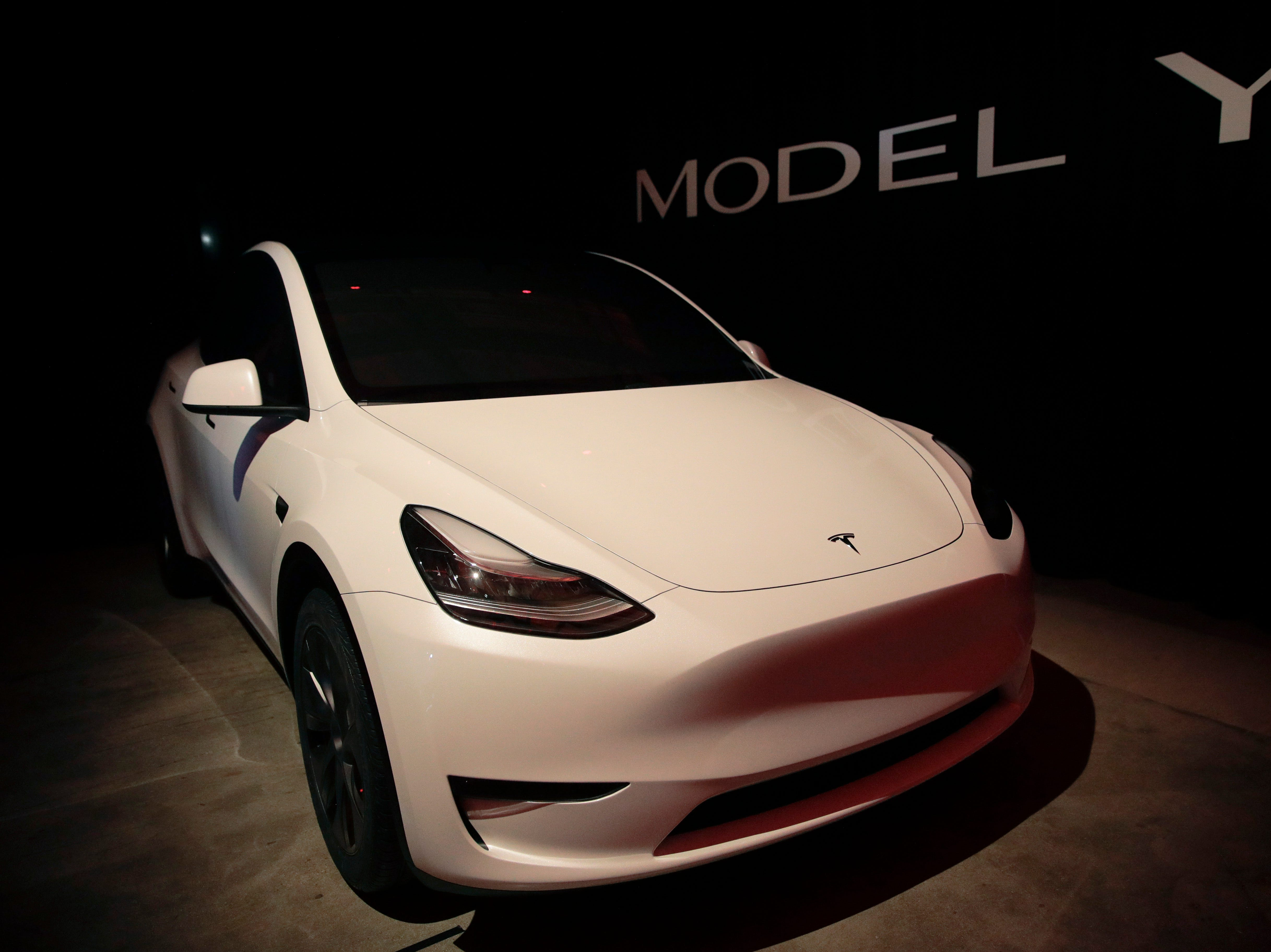 Tesla's Model Y is displayed at Tesla's design studio Thursday, March 14, 2019, in Hawthorne, Calif. The Model Y may be Tesla's most important product yet as it attempts to expand into the mainstream and generate enough cash to repay massive debts that threaten to topple the Palo Alto, California, company. (AP Photo/Jae C. Hong)