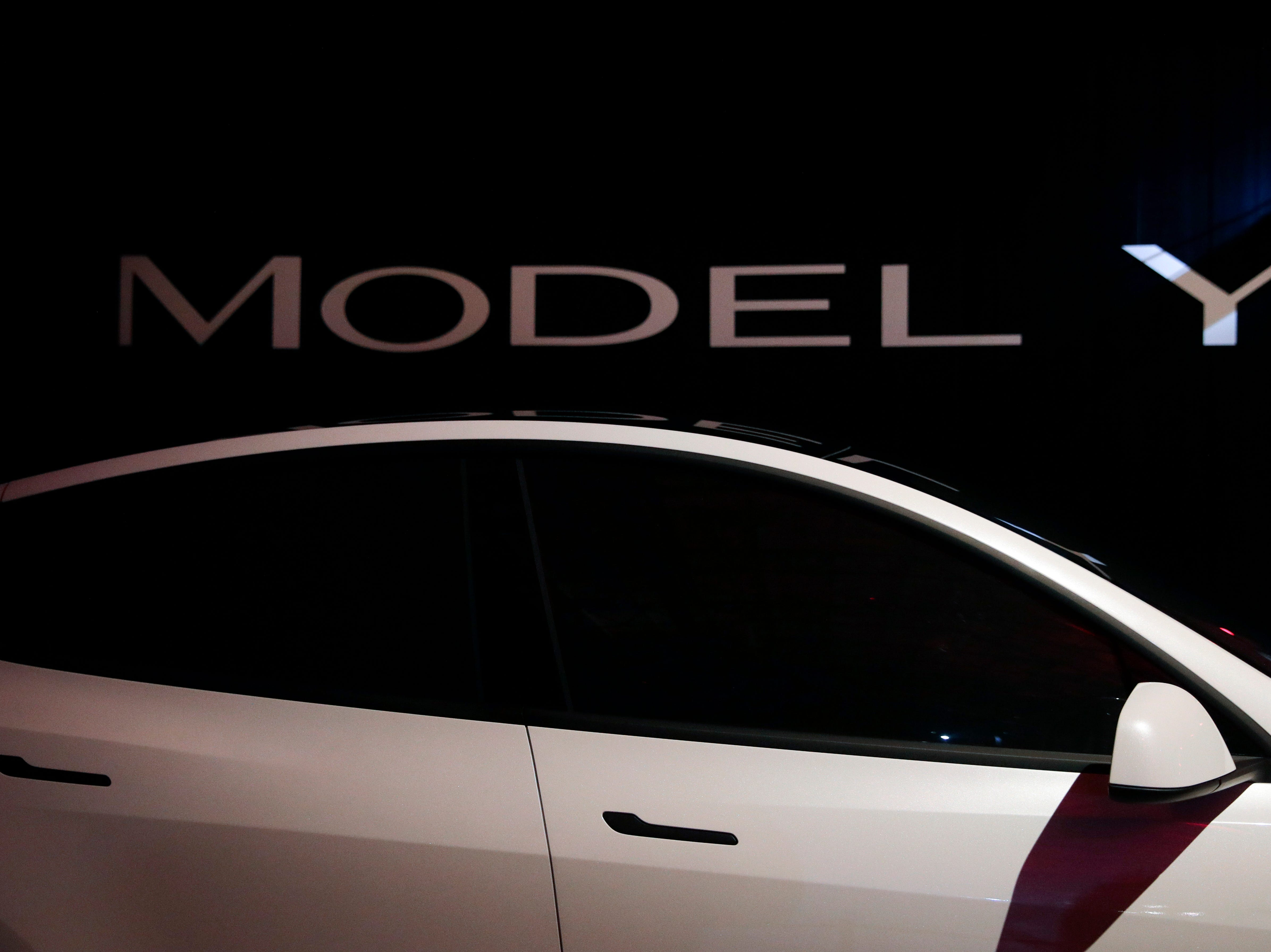Tesla's Model Y is displayed at Tesla's design studio Thursday, March 14, 2019, in Hawthorne, Calif. The Model Y may be Tesla's most important product yet as it attempts to expand into the mainstream and generate enough cash to repay massive debts that threaten to topple the Palo Alto, Calif., company. (AP Photo/Jae C. Hong)