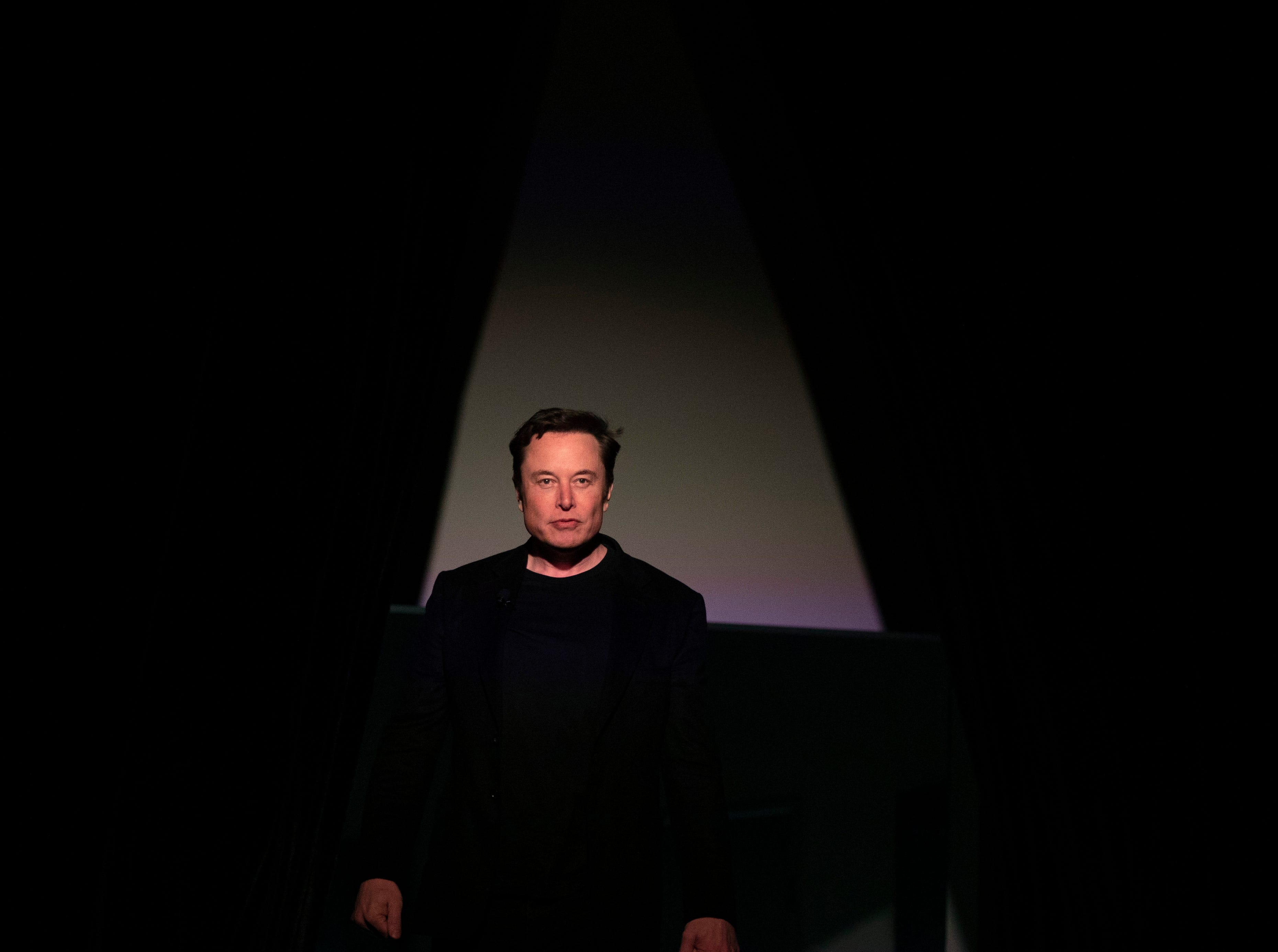 Tesla CEO Elon Musk walks onto the stage to introduce the Model Y at the company's design studio Thursday, March 14, 2019, in Hawthorne, Calif. The Model Y may be Tesla's most important product yet as it attempts to expand into the mainstream and generate enough cash to repay massive debts that threaten to topple the Palo Alto, California, company. (AP Photo/Jae C. Hong)
