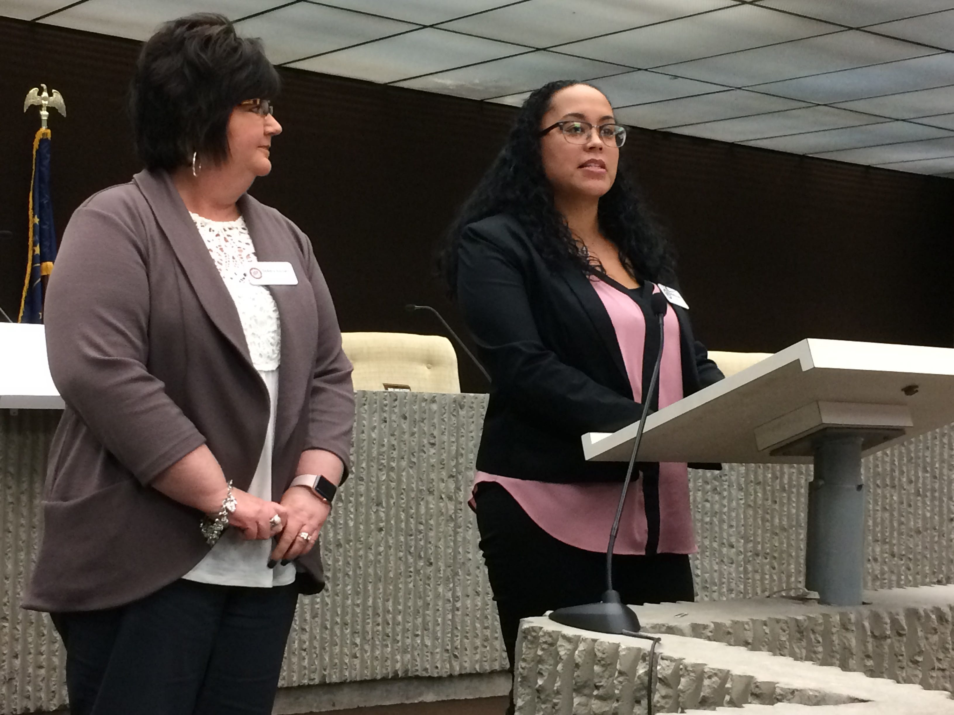 Samantha Lewis (right) speaks during an expanded Juvenile Detention Alternatives Initiative steering committee meeting Wednesday as DeAdra Baldwin listens.