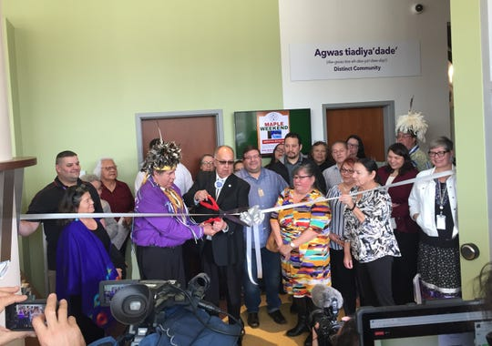 Seneca Nation leaders cut the ribbon to display Cornplanter's pipe-tomahawk on March 14, 2019.