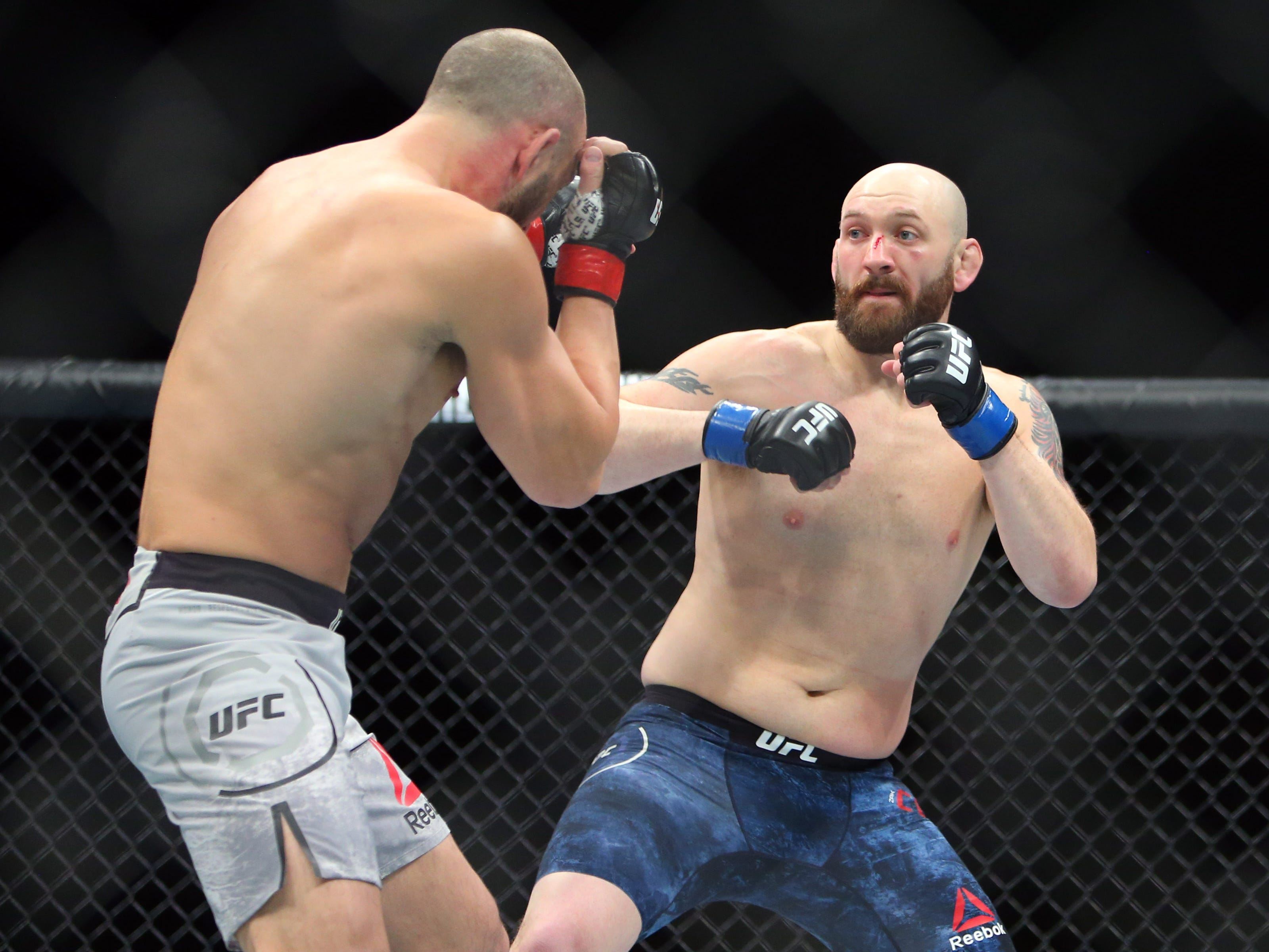 Trevor Smith (red gloves) and Zak Cummings (blue gloves) during UFC Fight Night at Fiserv Forum. Cummings is scheduled to fight Trevin Giles on May 18 in Rochester.