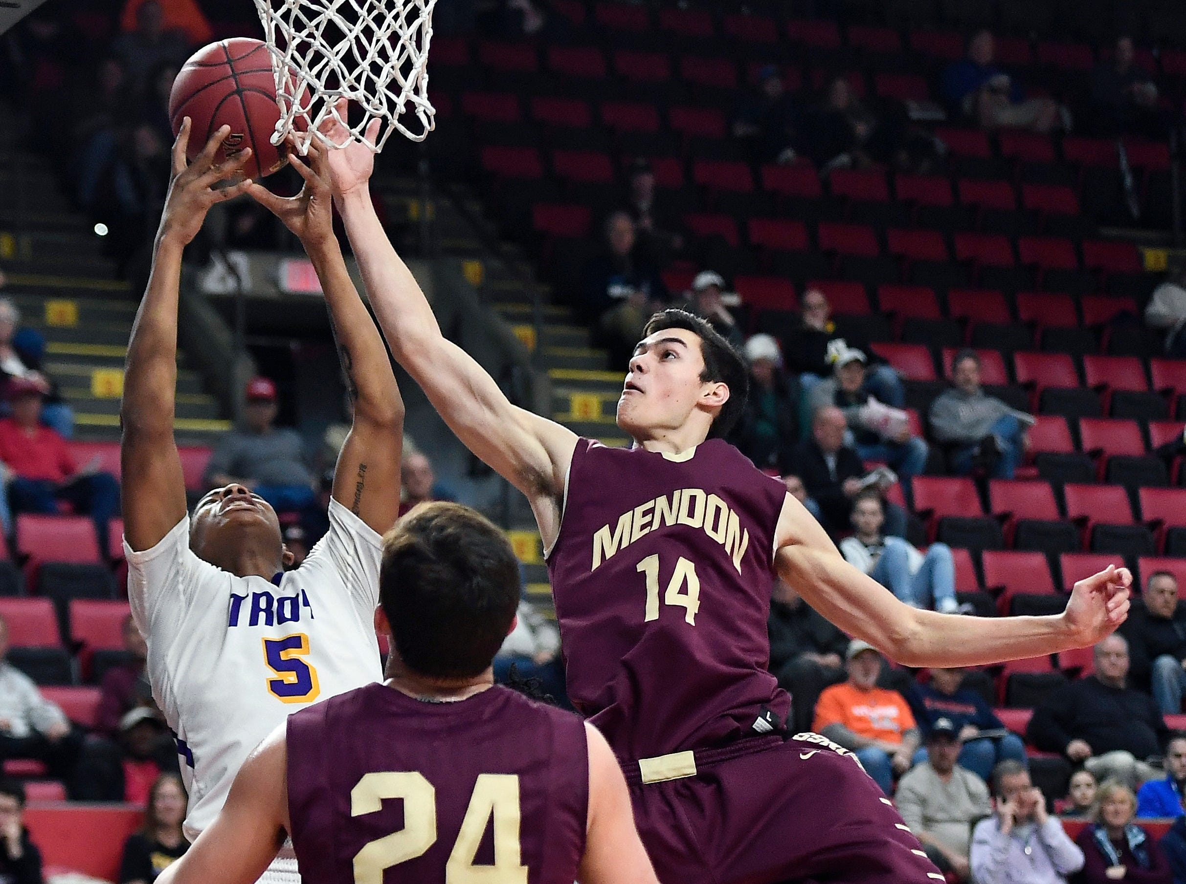 Pittsford Mendon's Dan Cook, right, reaches for a rebound against Troy's Lateef Johnson.