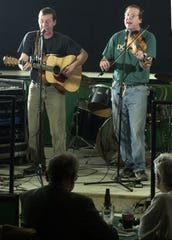 March 9, 2000: The Dady Brothers, John, left, and Joe play at the Fiddlers Green in Charlotte.