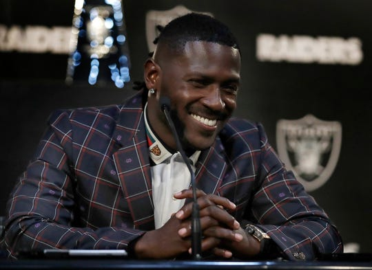 Oakland Raiders wide receiver Antonio Brown smiles during an NFL football news conference Wednesday in Alameda, California. Brown was traded from the Pittsburgh Steelers.