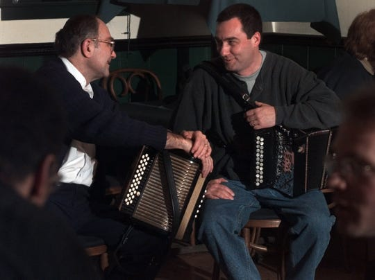 Feb. 28, 2000: Dave Halligan and music mentor Ted McGraw, left, chat during a break in the music atan Irish music session at Fiddlers Green.