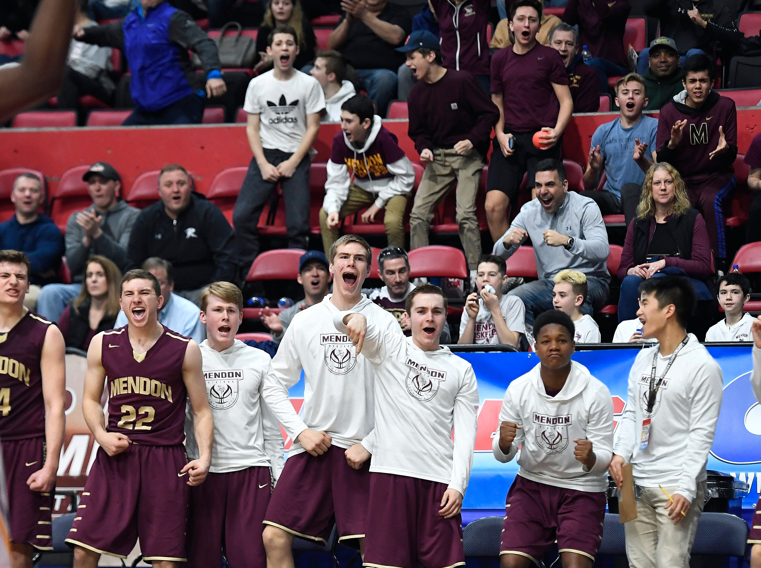 Pittsford Mendon's bench reacts to a Vikings' basket during a Class A semifinal at the NYSPHSAA Boys Basketball Championships in Binghamton.
