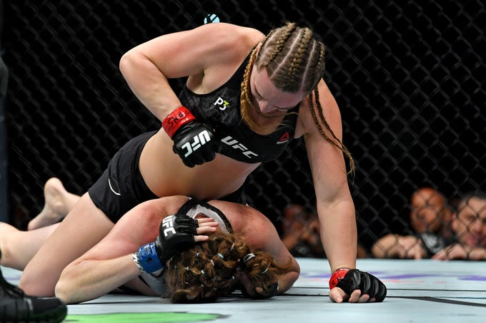 Aspen Ladd (red gloves) fights Tonya Evinger during UFC 229 at T-Mobile Arena in Las Vegas on Oct. 6, 2018.  Ladd is scheduled to fight Sijara Eubanks in Rochester on May 18.
