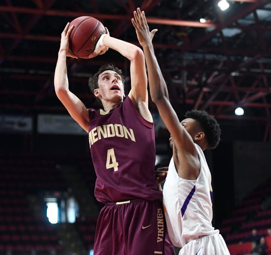 Pittsford Mendon's Connor Krapf, left, shoots over Troy's Nasir Soto during a Class A semifinal.