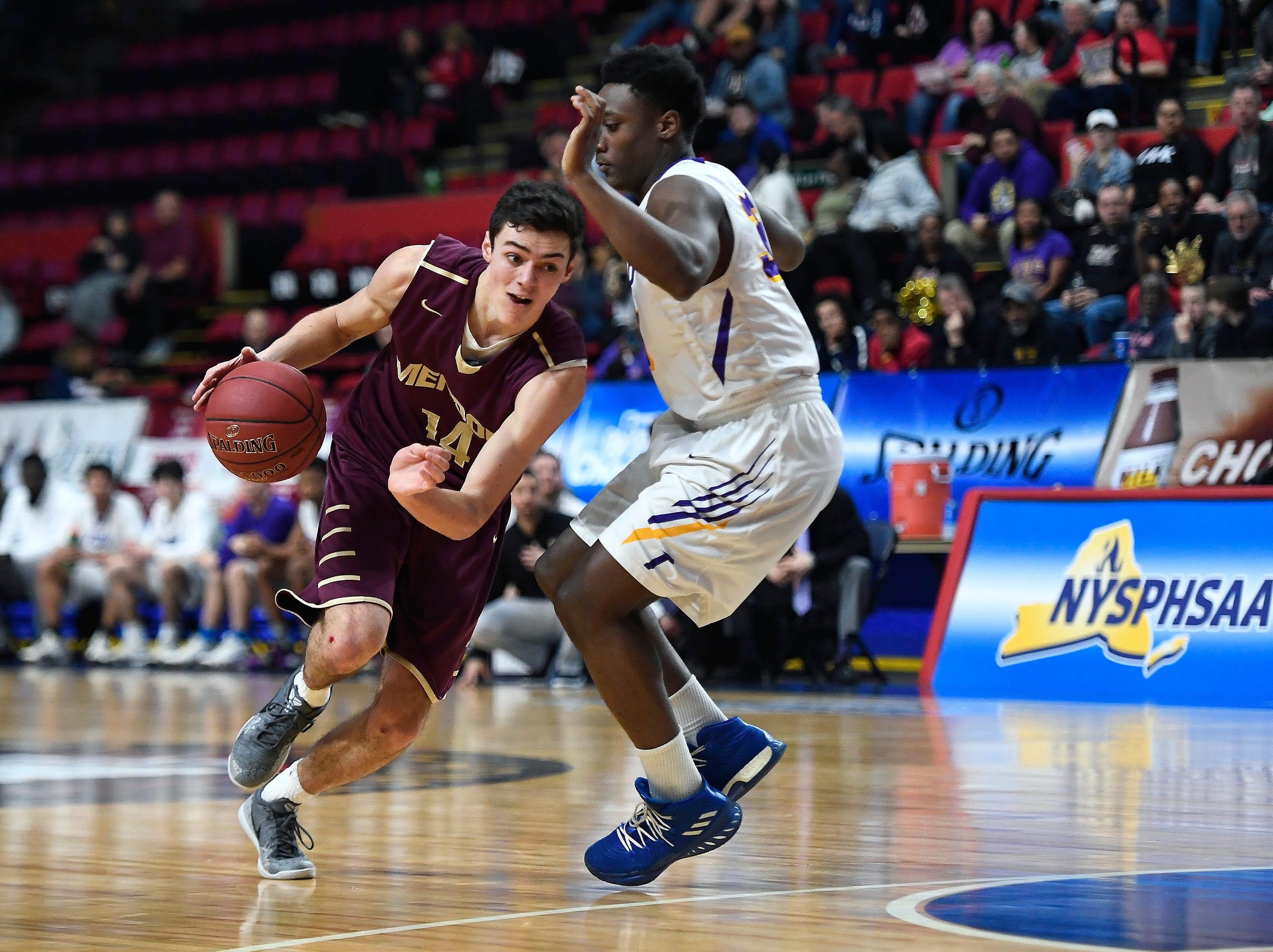 Pittsford Mendon's Dan Cook, left, is defended by Troy's Isaiah Smith during a Class A semifinal at the NYSPHSAA Boys Basketball Championships.