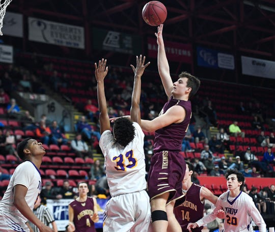 Pittsford Mendon's Nate Strauf, right, shoots over the defense of Troy's Zaveon Little during a Class A semifinal at the NYSPHSAA Boys Basketball Championships.