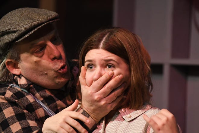 """Impending tragedy awaits as Lennie (Don Tamblyn) gets carried away while stroking the hair of Curley's wife (Chloe Freeland) in a scene from John Steinbeck's """"Of Mice and Men."""" The drama opens Saturday at Riverfront Playhouse."""