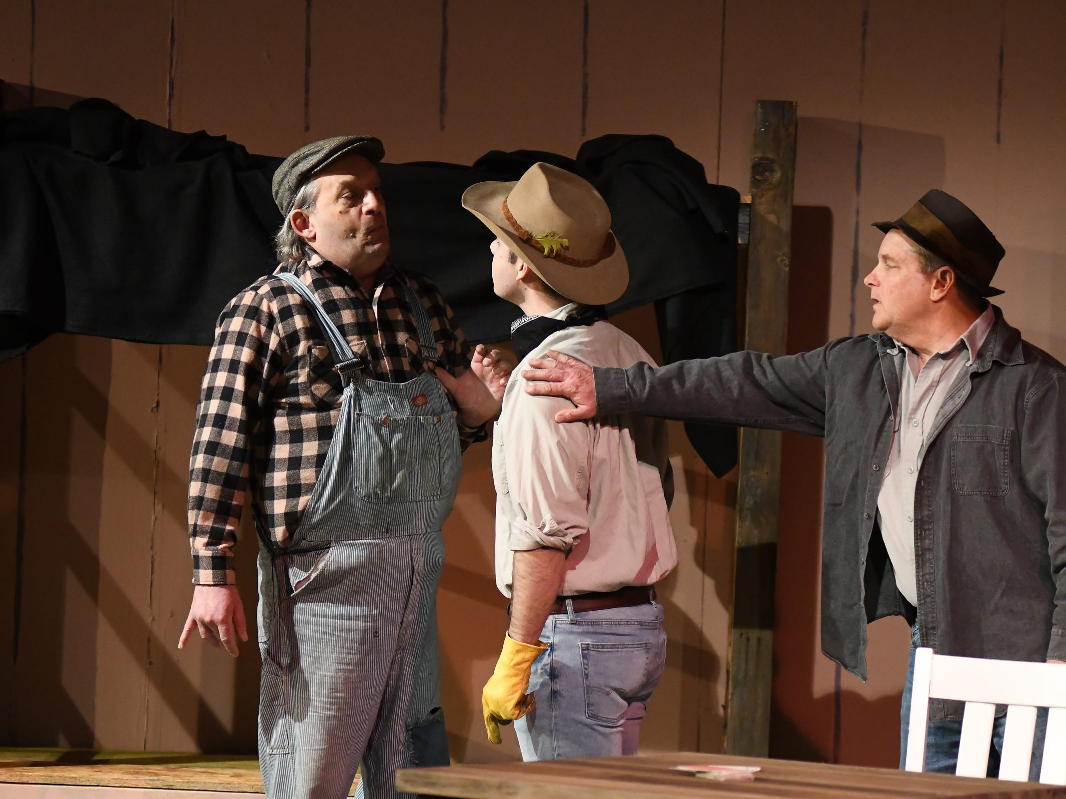 """Tension mounts as Lennie (Don Tamblyn), left, is confronted by hot-tempered Curley (Dustin Davis) as George (Russell Piette) intervenes in a scene from John Steinbeck's """"Of Mice and Men."""" The drama opens Saturday at Riverfront Playhouse."""