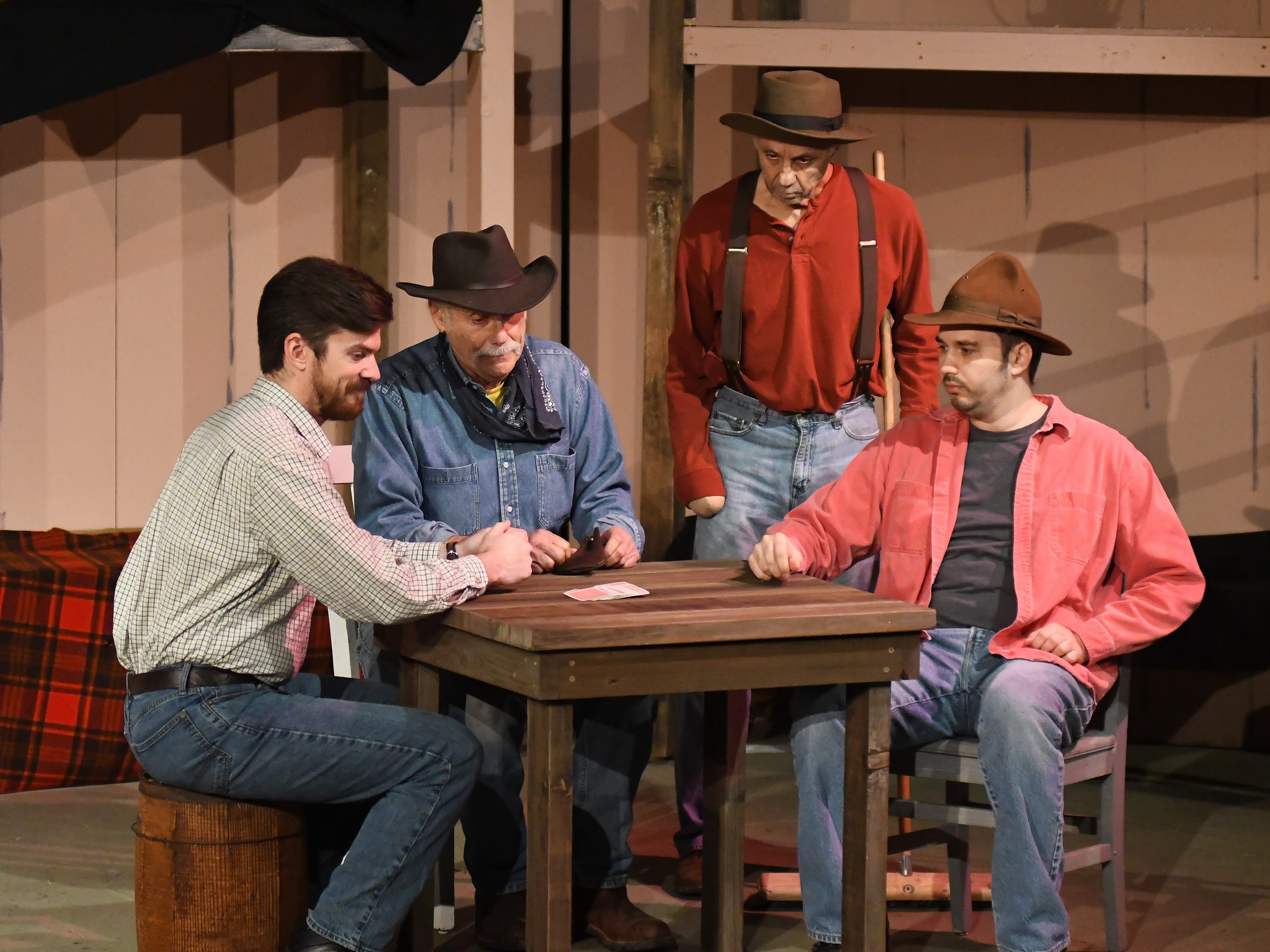 """Ranch hands pass time with a card game in a scene from John Steinbeck's """"Of Mice and Men."""" The drama opens Saturday at Riverfront Playhouse."""