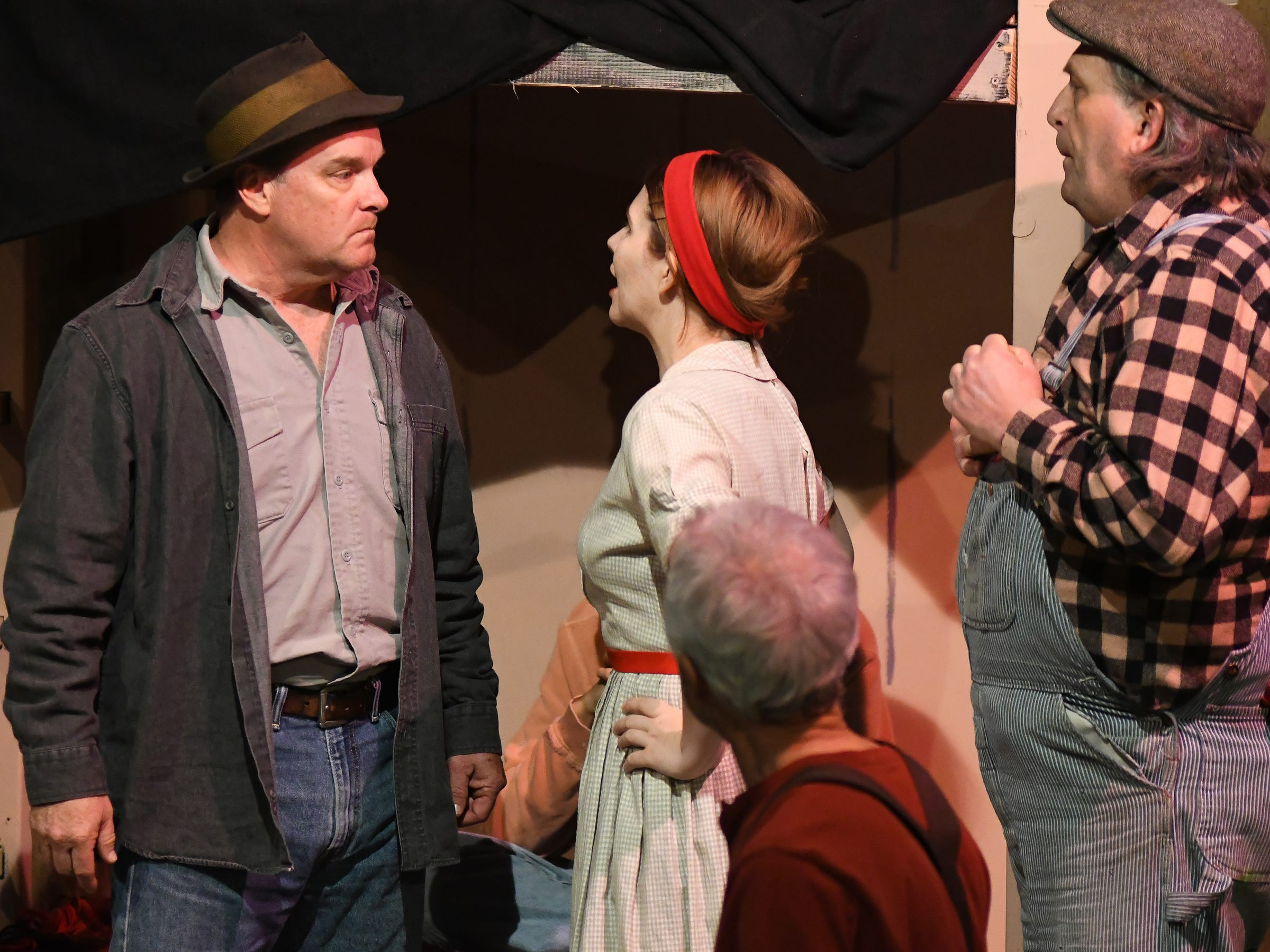 """Chloe Freeland, as Curley's wife, confronts George (Russell Piette), left, while the mentally challenged Lennie (Don Tamblyn) reacts in a scene from John Steinbeck's """"Of Mice and Men."""" The drama opens Saturday at Riverfront Playhouse."""