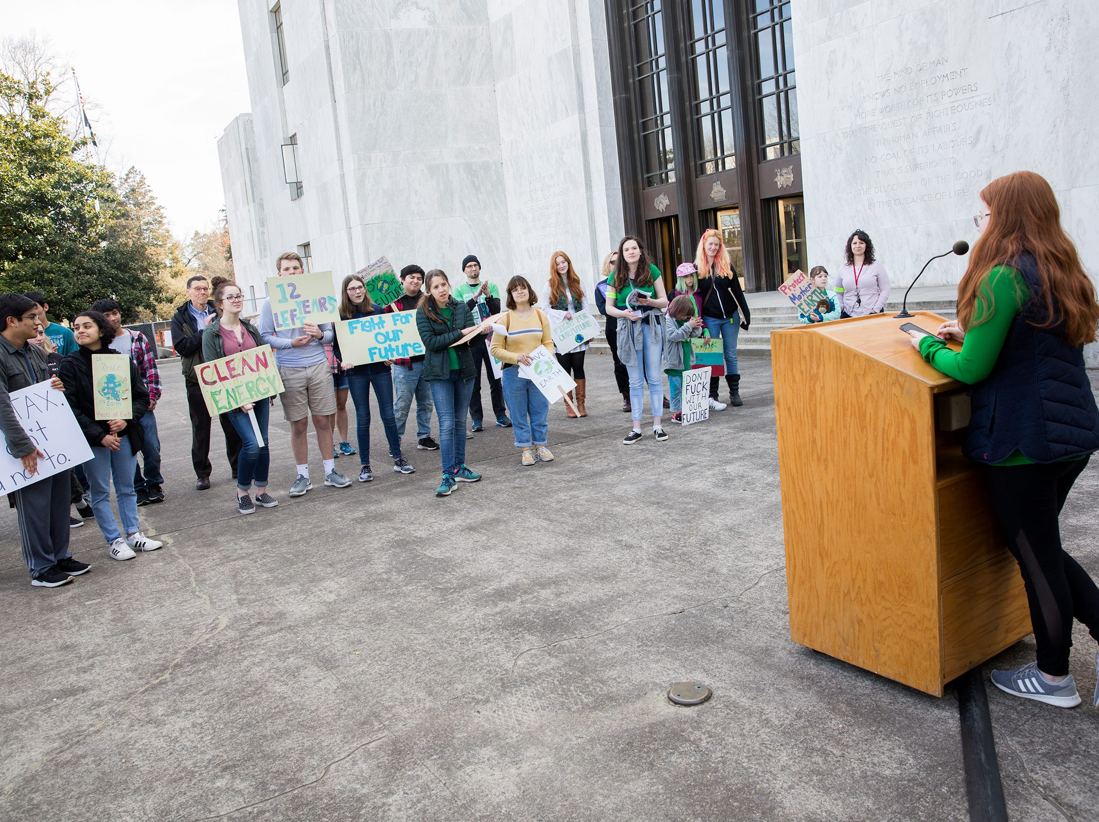 South Salem sophomore Eddy Binford-Ross, and student organizer of the rally, speaks to a crowd of around 30 in support of the Global Climate Strike and National Youth Climate Strike, at the Oregon State Capitol Building on March 15, 2019.