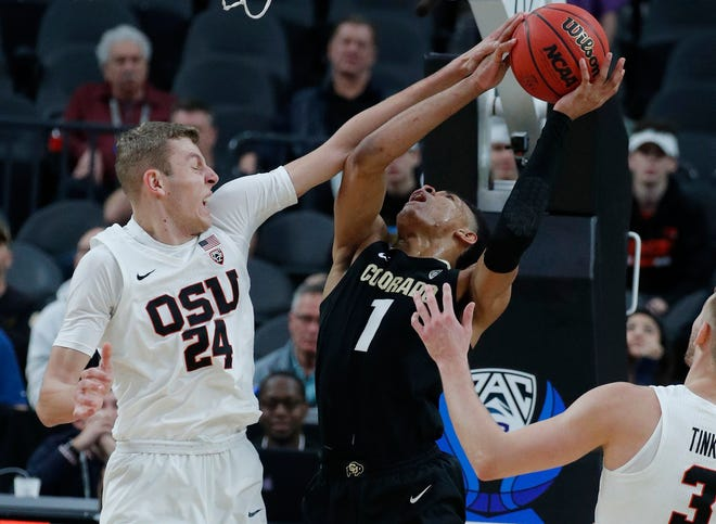 Colorado's Tyler Bey (1) tries to shoot around Oregon State's Kylor Kelley during the second half of an NCAA college basketball game in the quarterfinals of the Pac-12 men's tournament Thursday, March 14, 2019, in Las Vegas.