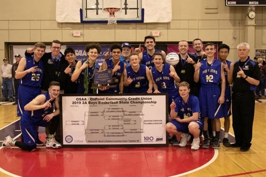 Western Christian's boys basketball team with the tournament bracket after winning the OSAA Class 2A state championship.