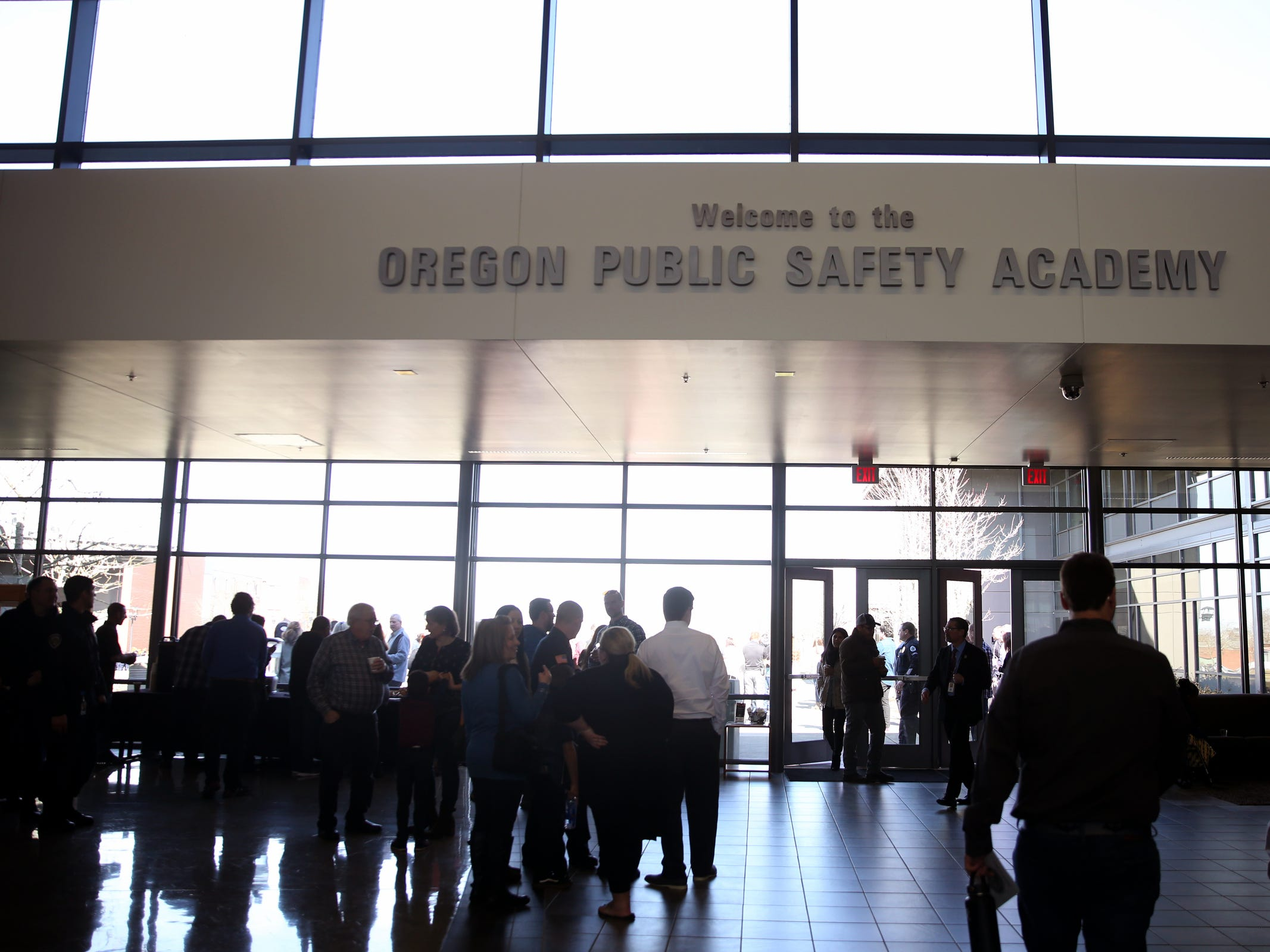 People gather in the lobby following a Basic Police Class graduation ceremony at the Department of Public Safety Standards and Training in Salem on March 15, 2019.