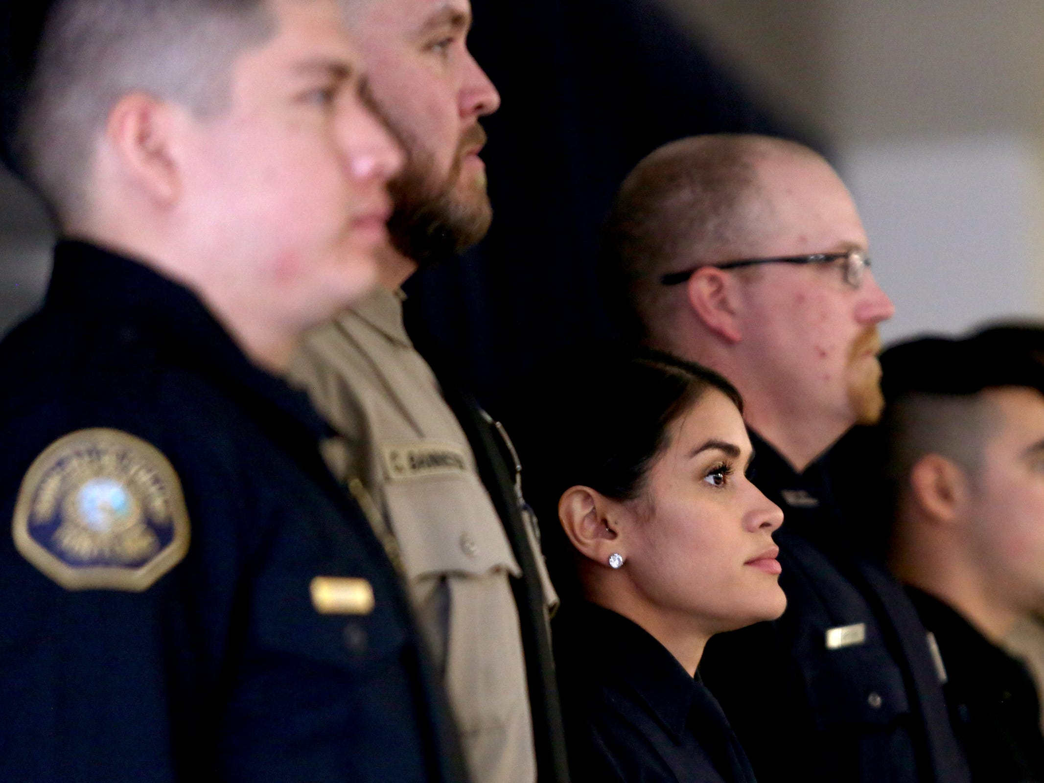 Gina Bell, a new Albany Police Officer, stands with other graduates during a Basic Police Class graduation ceremony at the Department of Public Safety Standards and Training in Salem on March 15, 2019.