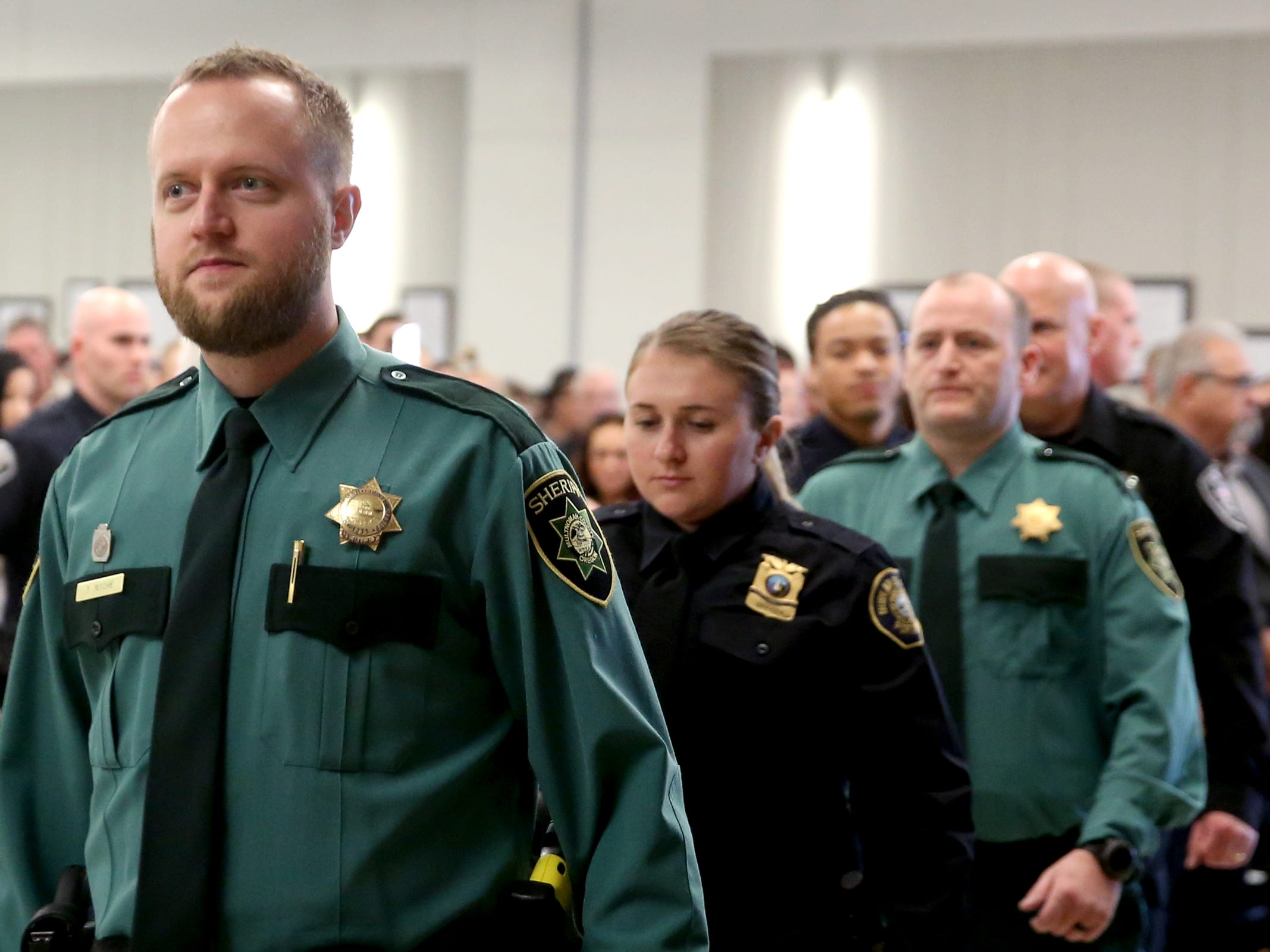 Graduates take to the stage for a Basic Police Class graduation ceremony at the Department of Public Safety Standards and Training in Salem on March 15, 2019.