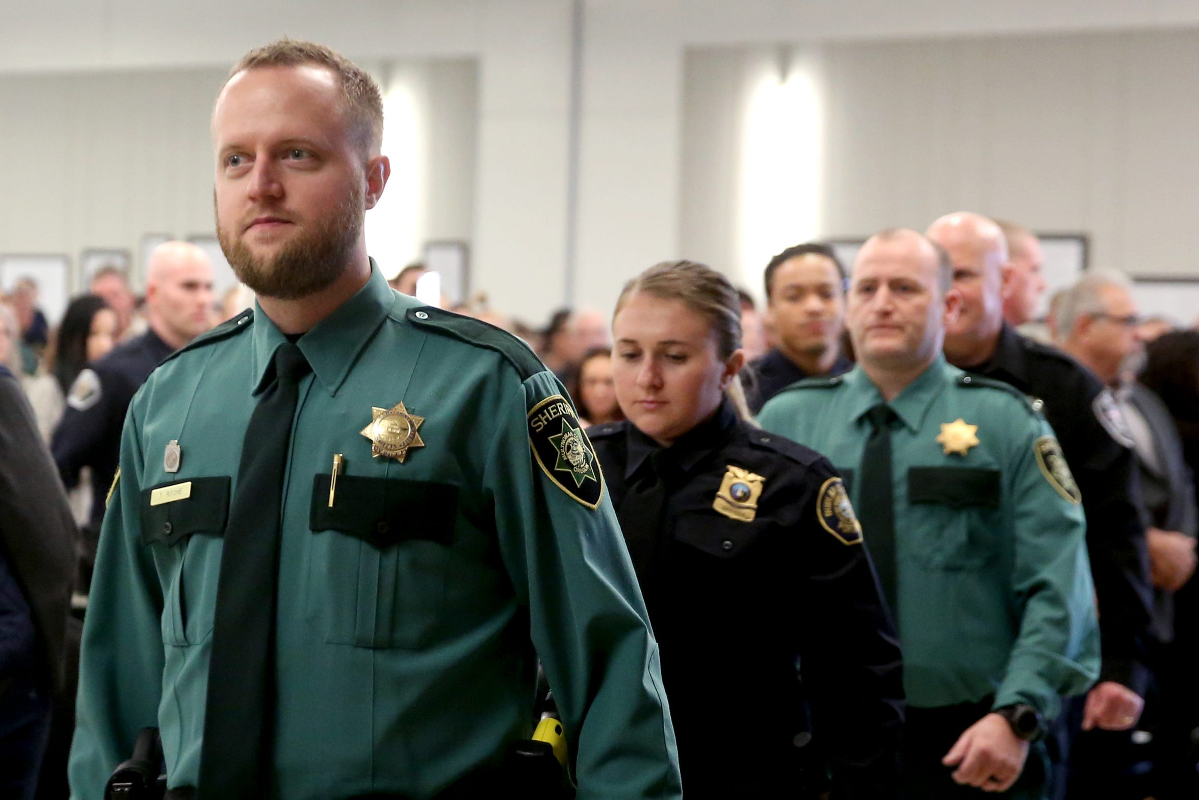 Graduates take to the stage for a Basic Police Class graduation ceremony at the Department of Public Safety Standards and Training in Salem on March 15. New recruits are being taught how to recognize and cope with stress on the job before they put on their badge and uniform.