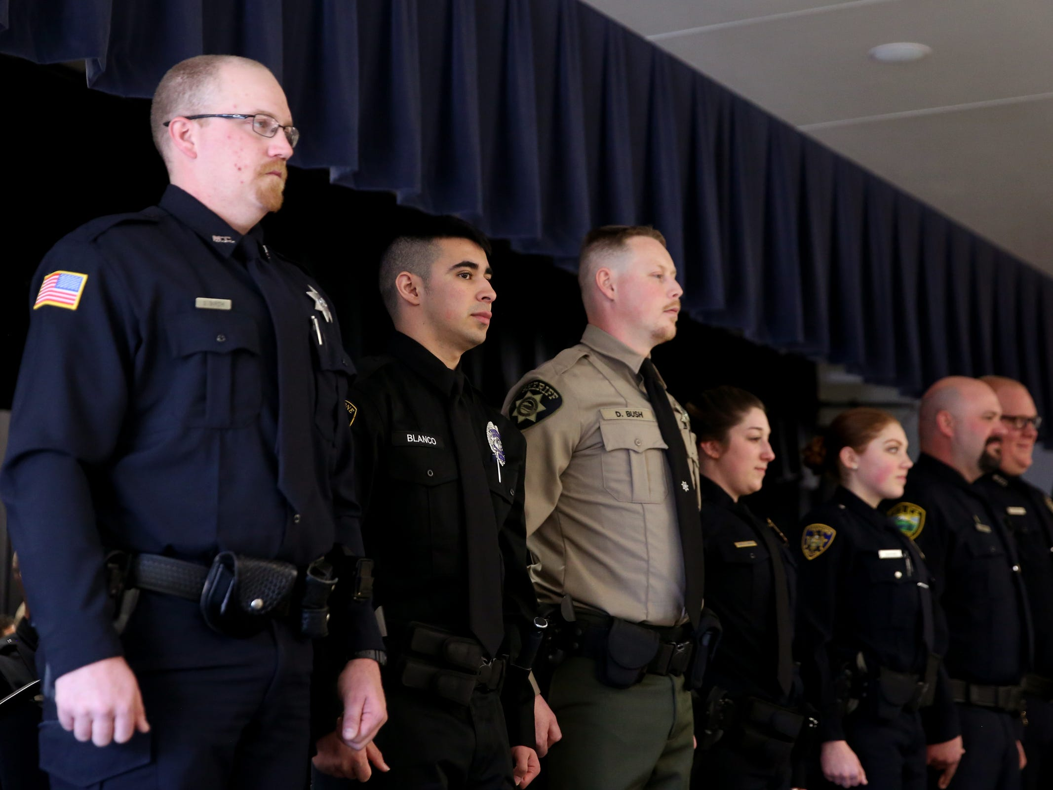 Graduates stand during a Basic Police Class graduation ceremony at the Department of Public Safety Standards and Training in Salem on March 15, 2019.