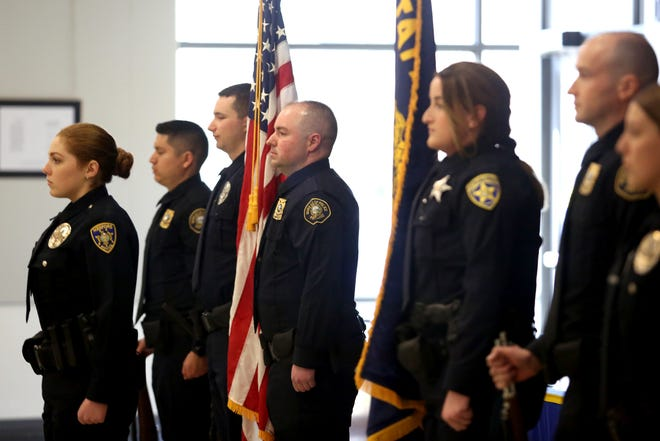 The colors are posted during a Basic Police Class graduation ceremony at the Department of Public Safety Standards and Training in Salem on March 15. New recruits are learning to recognize the signs of PTSD in themselves and being taught it's OK to seek assistance after a crisis.