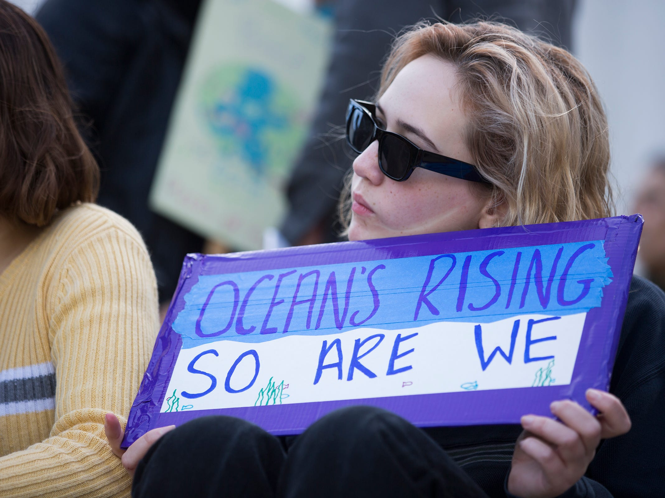 Ramona Skelding, a South Salem High School junior, holds a sign during a student rally for climate change, in support of the Global Climate Strike and National Youth Climate Strike, at the Oregon State Capitol Building on March 15, 2019.
