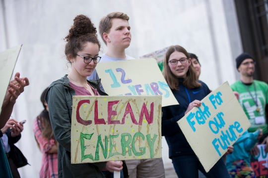 South Salem High School students listen to speakers during a student rally for climate change, in support of the Global Climate Strike and National Youth Climate Strike, at the Oregon State Capitol Building on March 15, 2019.