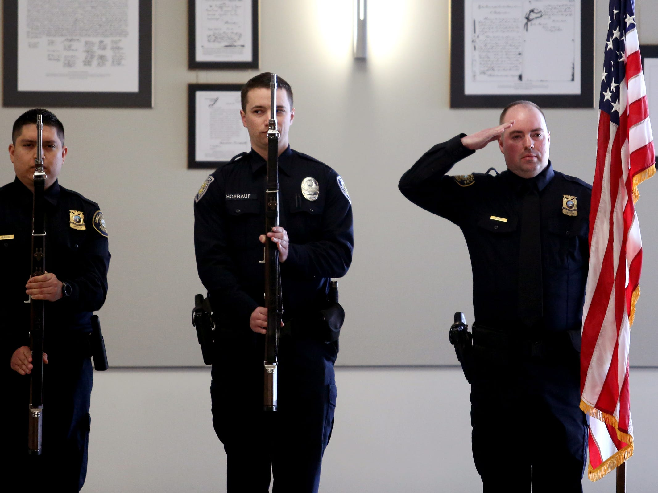 Graduates display the colors during the national anthem before a Basic Police Class graduation ceremony at the Department of Public Safety Standards and Training in Salem on March 15, 2019.