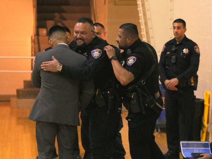 Officer Jorje Alvarado hugs Isidoro Medrano, who won both the department's officer of the year award and the medal of valor March 14, 2019, at the Salinas Police Department's 2018 awards ceremony.