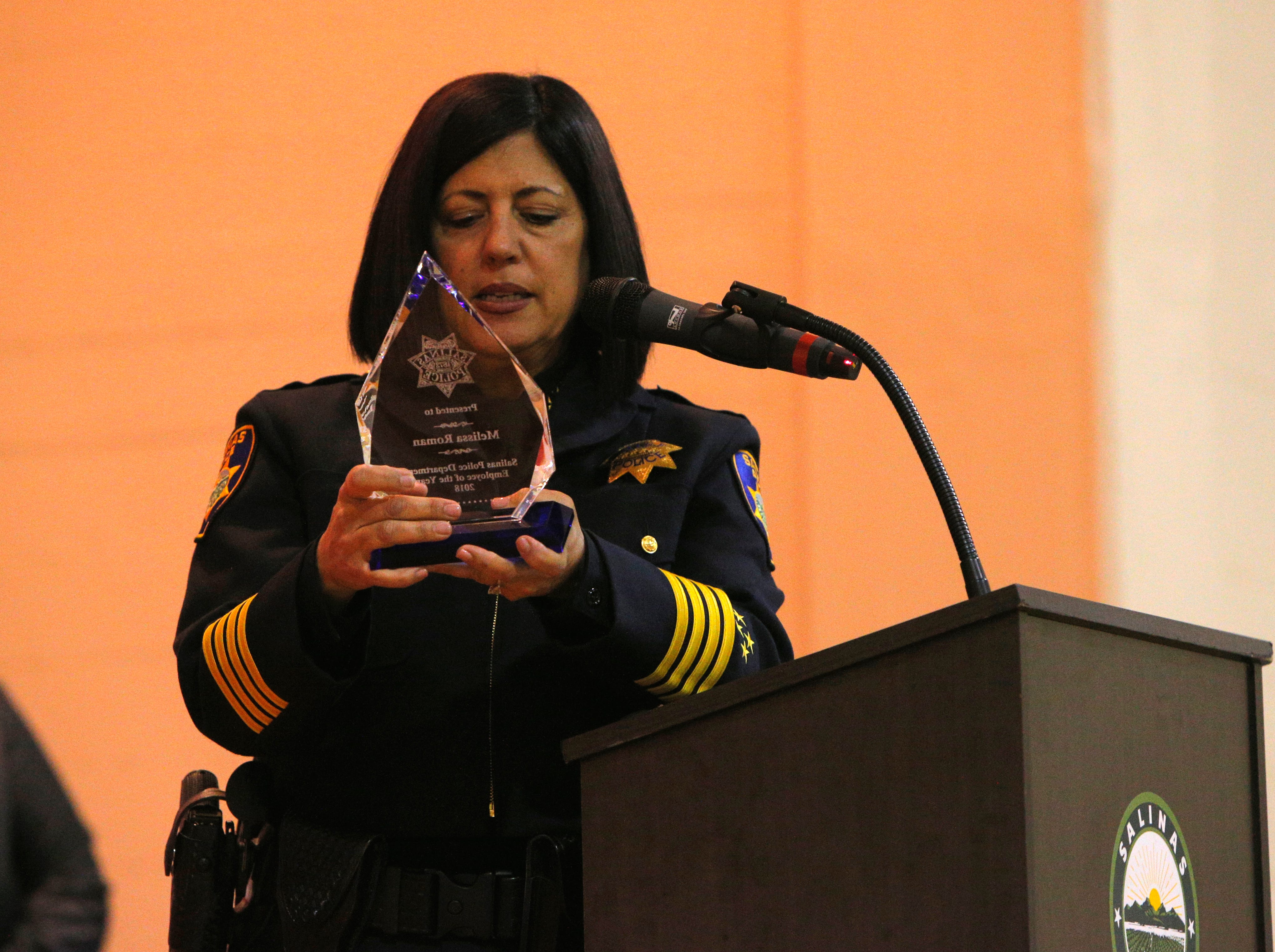 Salinas Police Chief Adele Fresé examines the employee of the year award March 14, 2019, at the Salinas Police Department's 2018 awards ceremony.