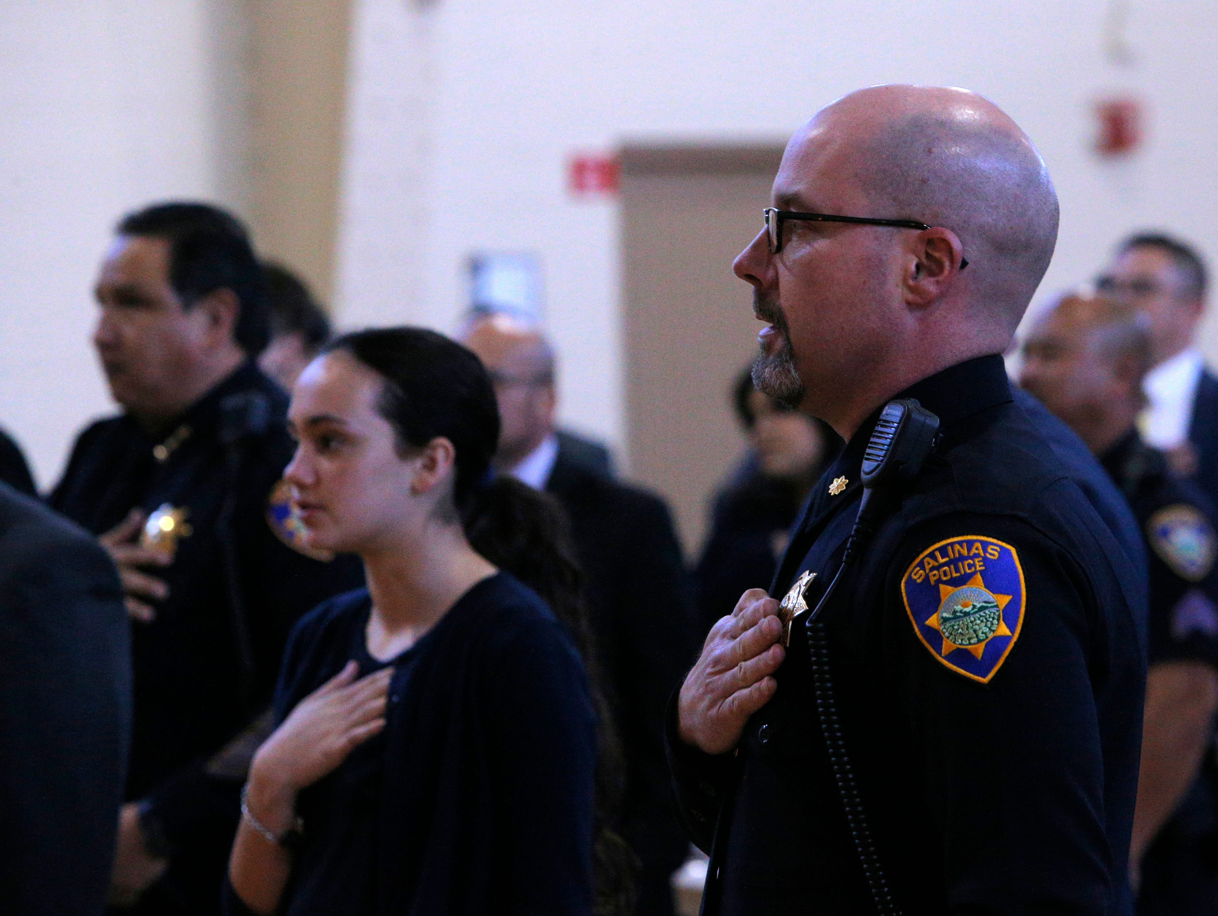 Salinas police Cmdr. John Murray recites the Pledge of Allegiance March 14, 2019, at the Salinas Police Department's 2018 awards ceremony.