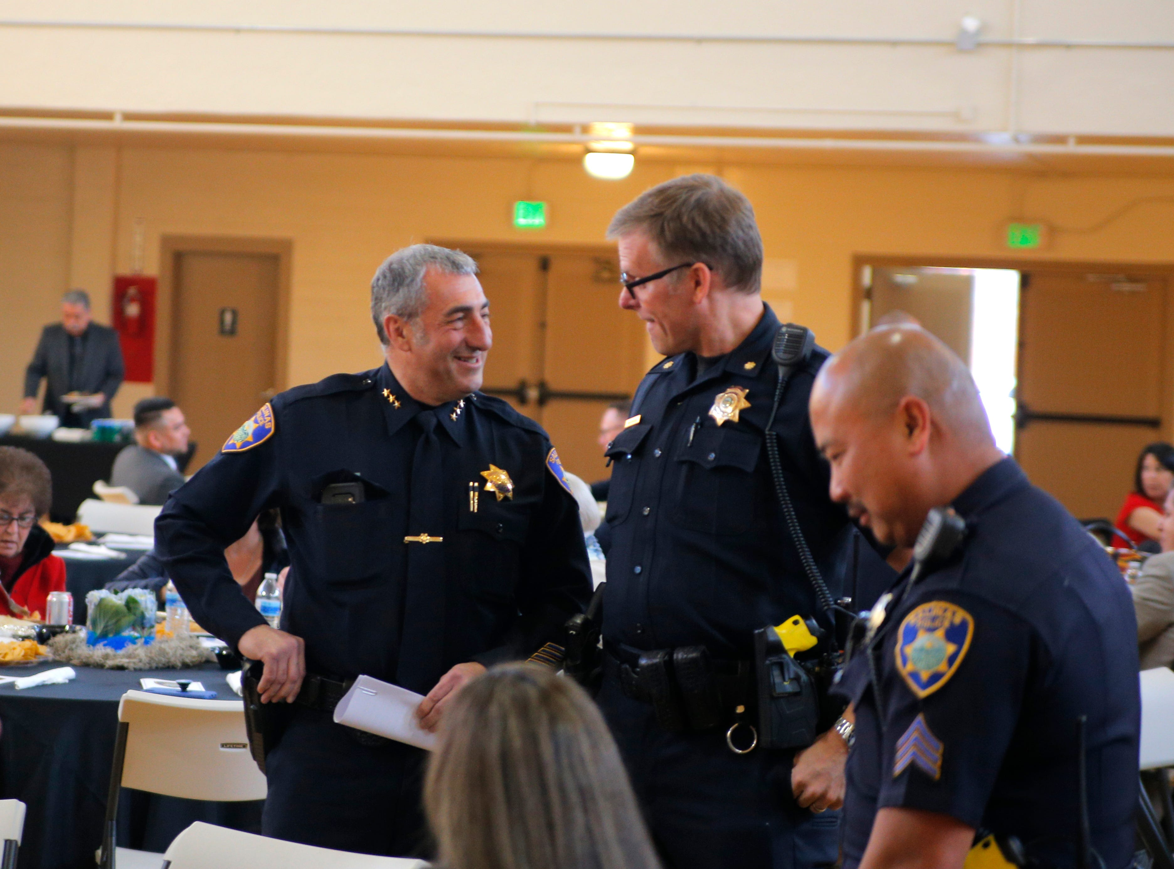 Salinas Police Asst. Chief Roberto Filice (left) speaks with Cmdr. Vince Maiorana at the department's 2018 awards ceremony March 14, 2019.