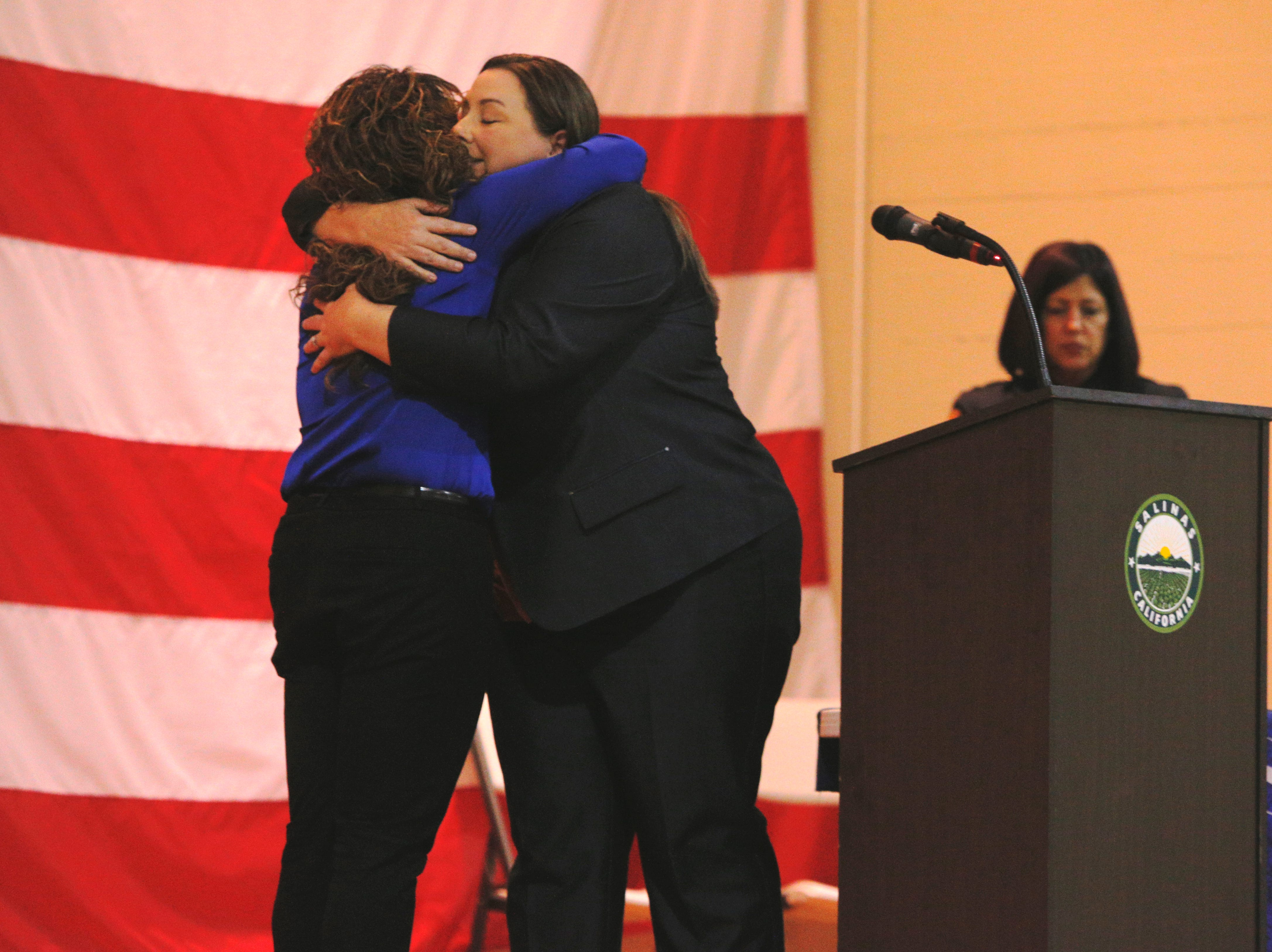 Cmdr. Kim Robinson hugs Community Service Officer Melissa Ramon, who won employee of the year March 14, 2019, at the Salinas Police Department's 2018 awards ceremony.